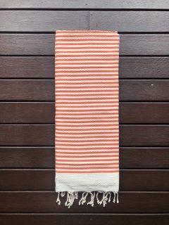 Extra large beach towel on sandy beach
