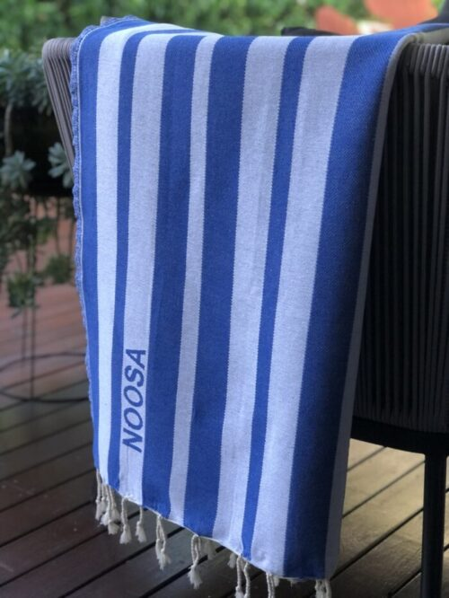 Beach towel hanging over deck chair
