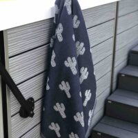 Beach towel hanging by the pool