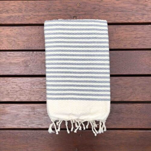 Grey and white striped folded beach towel