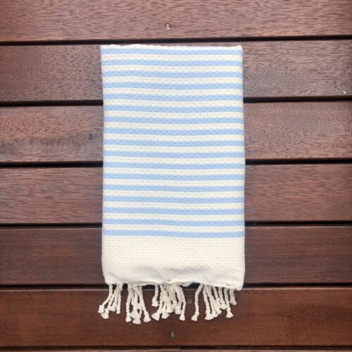 Folded beach towel laying on the deck