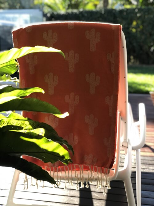 Beach towel hanging over a deck chair